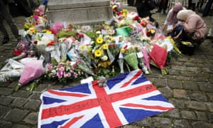 People leave floral tributes to Cox in Market Square.