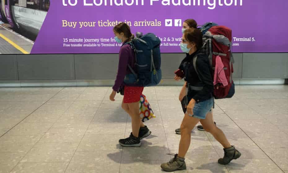 Passengers on a flight from Madrid arrive at Heathrow on Sunday