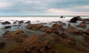 A rocky part of the seashore in Playas, Ecuador.