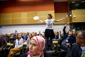 An Extinction Rebellion protester interrupts a climate change conference in Brussels, Belgium