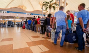 Passengers line up to depart Sharm el-Sheikh airport