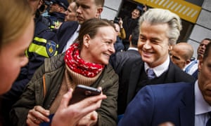 Geert Wilders of the far-right Freedom party hands out flyers against the association treaty with Ukraine ahead of Wednesday's referendum