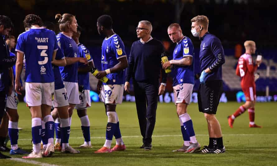 Oldham's manager Keith Curle with his players during the Carabao Cup tie against Accrington.