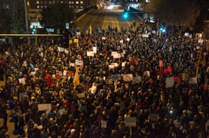 Protesters gather at an intersection outside the Humphrey school of affairs on the University of Minnesota campus