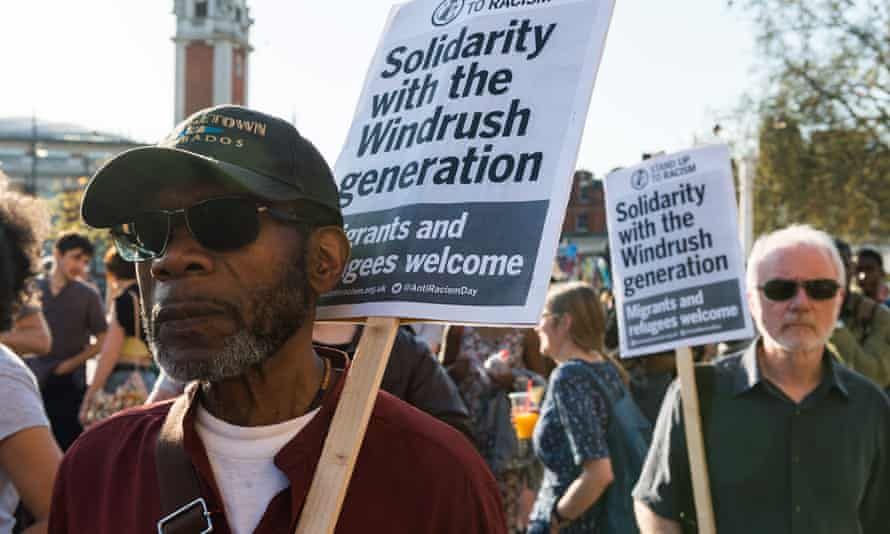 Protesters take part in a rally in Brixton, south London