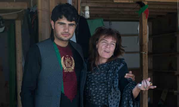 Volunteer Liz Clegg and a young man in the Calais refugee camp.