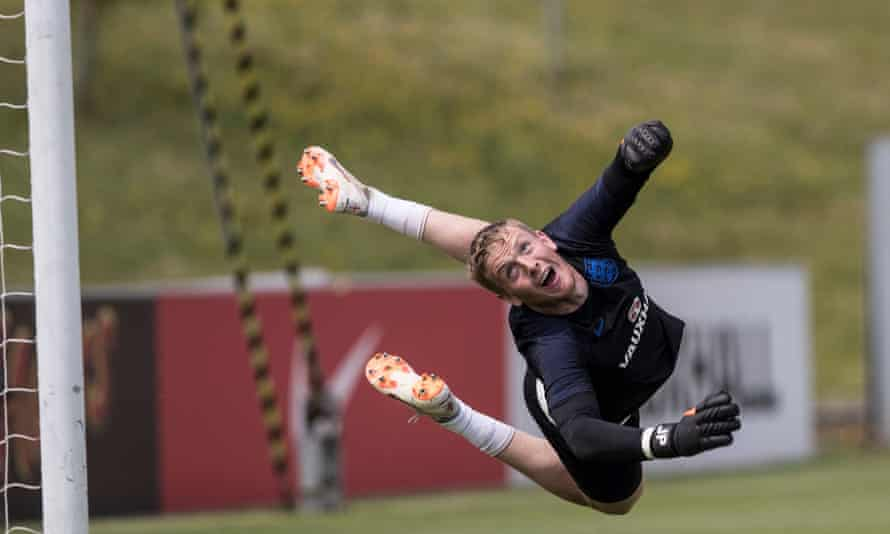 Jordan Pickford makes a save during training with the England squad at St George's Park.