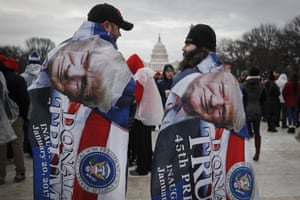 Trump supporters wrapped in flags on the National Mall