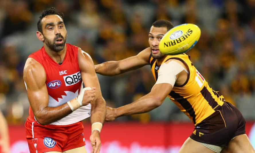 Goodes handballs whilst being tackled by Josh Gibson during the Swans' victory over the Hawks in the weekend's grand final rematch at the MCG.