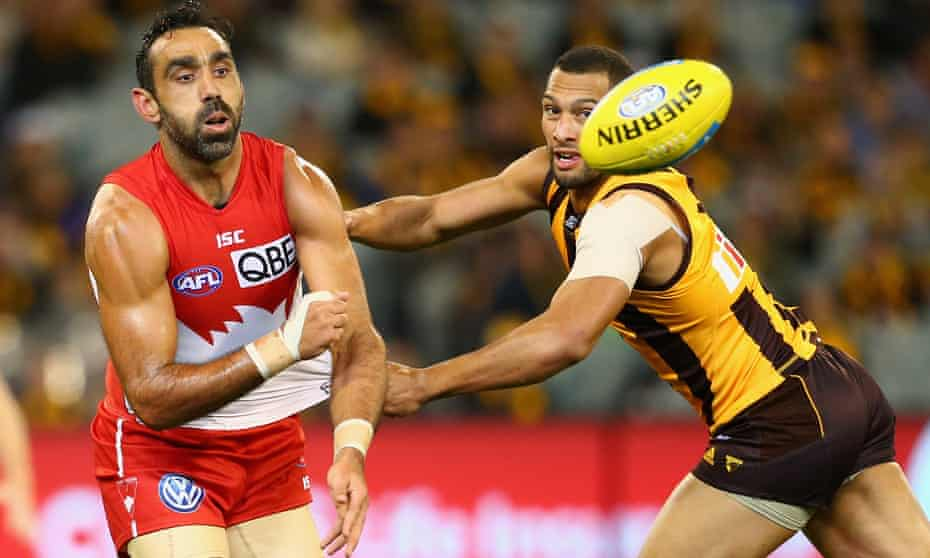Adam Goodes (left) in action for Sydney Swans in a match against Hawthorn in May 2015, his final season in the AFL.