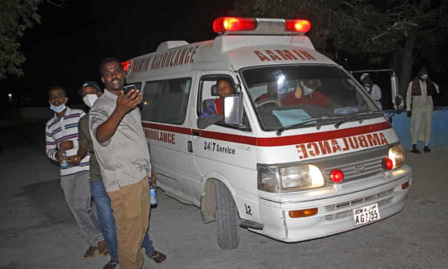 An ambulance carrying wounded from a blast at a popular restaurant arrives a hospital in the capital Mogadishu, Somalia