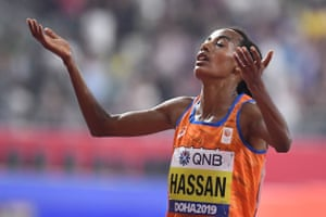 Sifan Hassan celebrates after winning the women's 10,000m final.