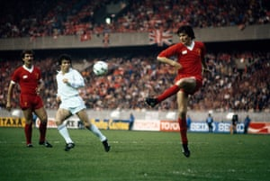 Real Madrid's Juantito, centre, was one of those causing problems but here Liverpool's Alan Hansen clears the ball from danger