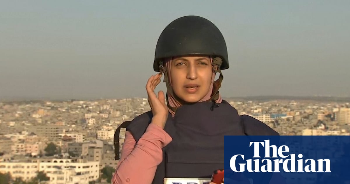 Journalist reports live from Gaza as neighbouring building hit by Israel airstrike – video