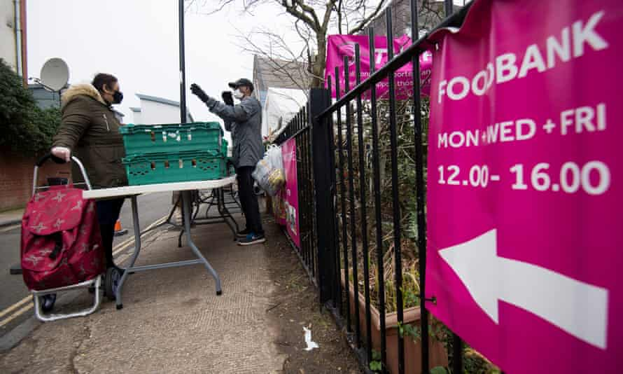 People queue at the Ringcross foodbank in north London last month