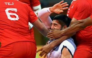 Nikola Karabatic of France is clobbered during the handball between France and Tunisia.