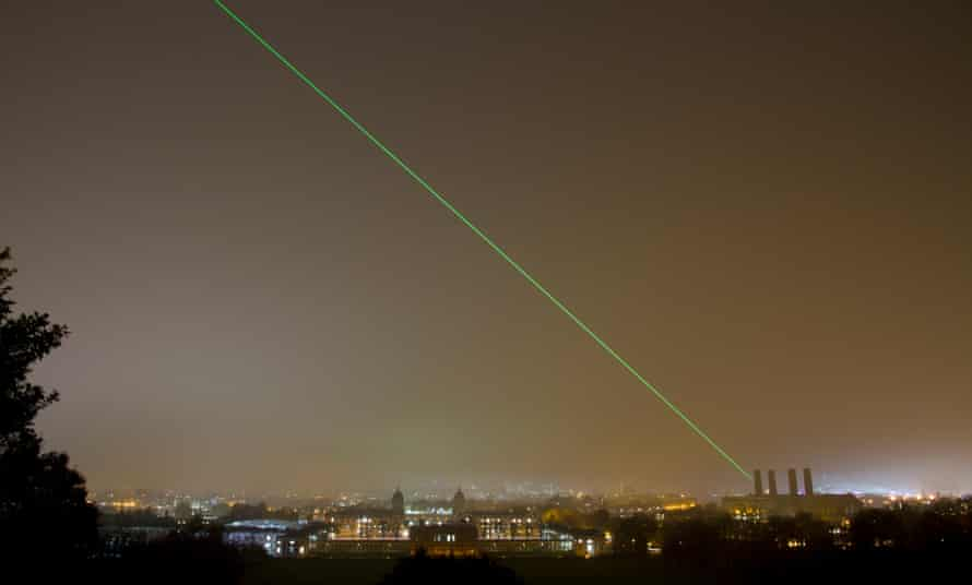Laser being projected from the Royal Observatory at Greenwich across the London skyline marking the Prime Meridian line.