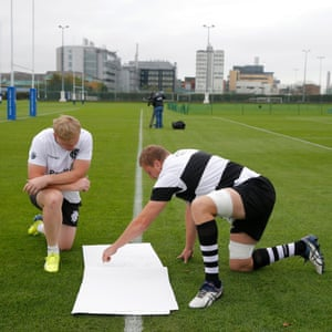 Adrian Strauss from South Africa, left, and Dominic Bird of New Zealand planning line-out moves at Barbarians training centre in West London.