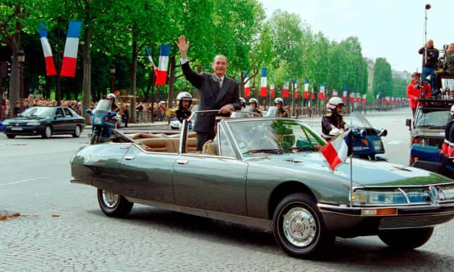 President Jacques Chirac in a Citroën SM in Paris, 1995.