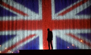 A man stands in front of a fountain illuminated with the colours of the UK flag in Zagreb.