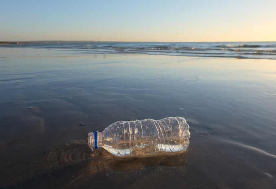 A plastic bottle litters a Melbourne beach