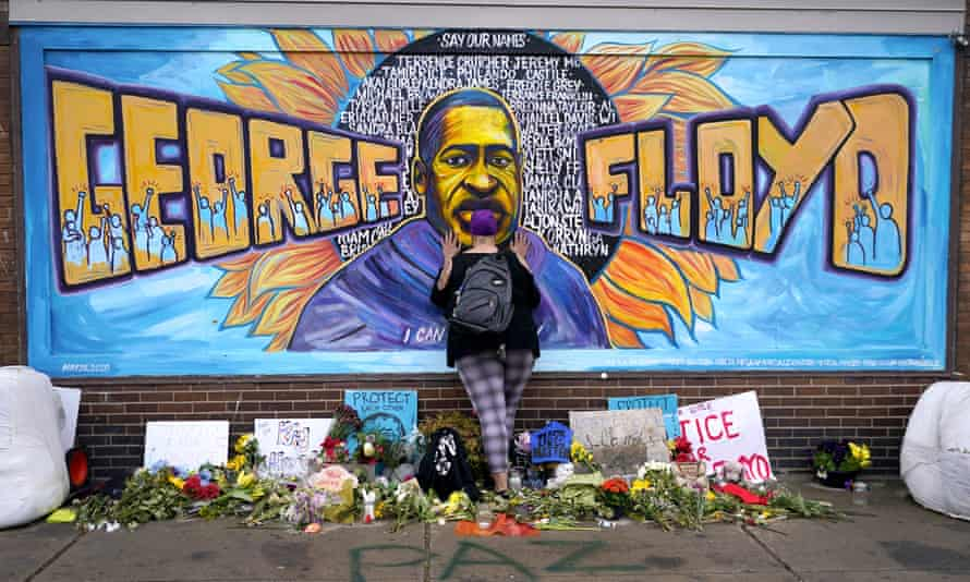 A mourner is seen at a mural at George Floyd Square in Minneapolis.