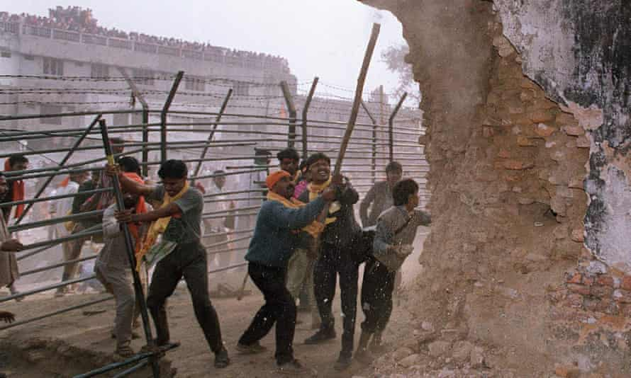 Indian Hindu nationalists attack the walls of 16th-century Babri mosque in December 1992
