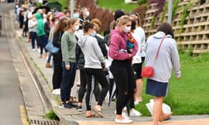 People queue for coronavirus testing in Wollongong, New South Wales, after a resident tested positive on Tuesday. NSW premier Gladys Berejiklian has announced 18 new Covid cases overnight, as six new cases are linked to a new 'Croydon cluster' in Sydney's inner west.
