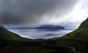 A beautiful landscape over looking the small island of Koltur as seen from the Island of Streymoy in the Islands. The island of Koltur seen in the picture is only populated by 2 people. Fog Faroe Islands, Denmark, mist