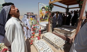 Residents visit the graves of their relatives.