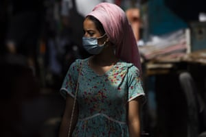 A woman wears a protective face mask to help curb the spread of Covid-19 in Tel Aviv, Israel, Sunday, 5 July, 2020.