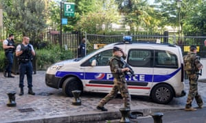 Police and military officers set up a security perimeter near the site of the incident in Levallois-Perret, Paris