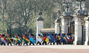 A guard of honour carrying the 53 Commonwealth flags arrives at Buckingham Palace ahead of the formal opening of the Commonwealth heads of government meeting.