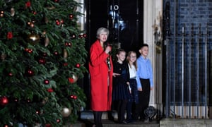Theresa May joins children to switch on the Christmas tree lights outside 10 Downing Street