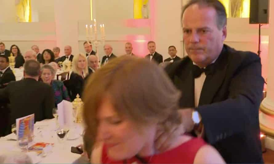 Mark Field manhandles Greenpeace protester Janet Barker from a black tie dinner