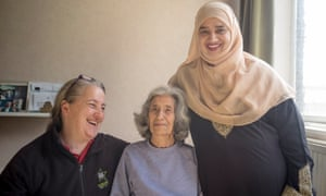 Sophie Spielman, centre, with Kay Ballard, left, and Khayrun Begum in Sophie's flat in Treves House.