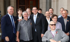 Victorian premier Daniel Andrews poses with former victims and representatives, before making an apology to the gay community at Parliament House on Tuesday.