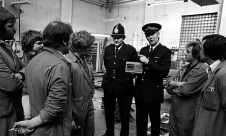 Police play 'the Ripper tape' to garage workers.