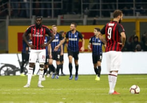 Tiemoué Bakayoko and Gonzalo Higuaín cut dejected figures after the late goal.
