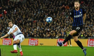 Tottenham Hotspur's Harry Winks sees this shot hit the bar.