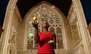 A performer juggling at the Circomedia circus training school based in St Paul's church in Bristol.
