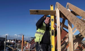 A construction worker on a Taylor Wimpey housing estate in Aylesbury