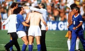 Italy's manager Enzo Bearzot embraces his players at the end as they celebrate victory.