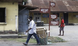 A man wearing face mask walks at the Yaba Mainland hospital.