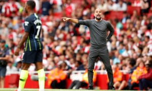 Manchester City manager Pep Guardiola shouts instructions towards Raheem Sterling, who scored against Arsenal on Sunday.