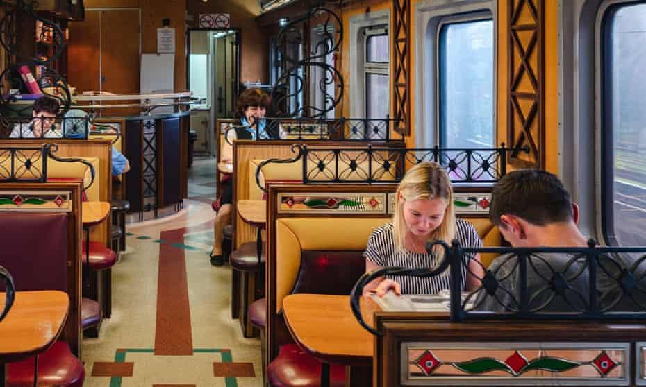 Passengers reading guidebooks aboard the Trans-Siberian Railway.