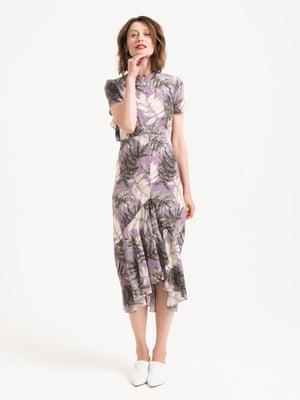 Model wears lilac grey white palm patterned silk dress, £299, whistles.com. white heeled mules, £149  jigsaw-online.com. Earrings, £12.99, zara.com.