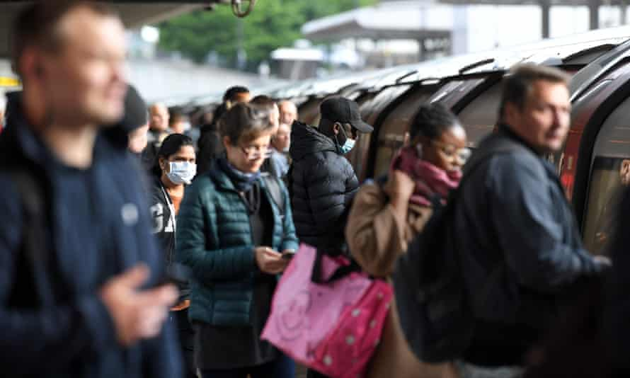 Commuters board a Jubilee line train to central London on Monday.