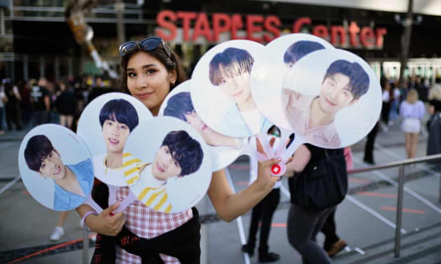"A fan awaits the BTS concert as part of the ""Love Yourself"" North American Tour at Staples Center, before the pandemic."
