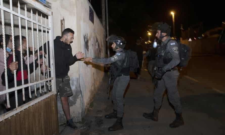 Israeli border police in Sheikh Jarrah, East Jerusalem, on 12 May.